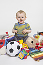 Portrait of baby boy playing with toys - MU001365