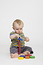 Baby boy playing with toys on white background - MU001364