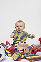 Portrait of baby boy playing with toys - MU001353