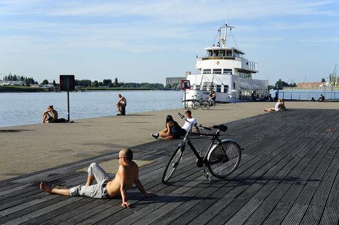 Belgium, Flanders, Antwerp, ship, people on a quay at the Schelde river - MIZ000409