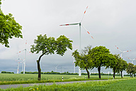 Germany, Mecklenburg-Vorpommern, View of wind turbine in field - MJF000355