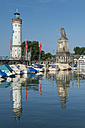 Germany, Bavaria, View of Port of Lindau with lighthouse and lion statue - ELF000364