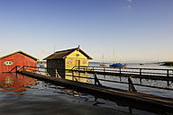 Germany, Bavaria, View of boathouse in lake - LH000255