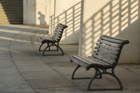 Germany, Berlin, Benches and shadow of man in background - FBF000092