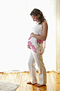 Germany, Brandenburg, happy young pregnant woman - BFRF000259