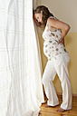 Germany, Brandenburg, exhausted young pregnant woman - BFRF000260
