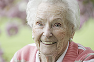 Germany, Cologne, Portrait of senior woman smiling, close up - JATF000199