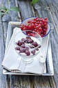 Rice pudding with cherries and red currant on table - OD000313