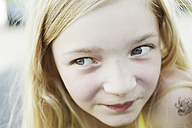 Germany, North Rhine Westphalia, Cologne, Girl looking away, smiling, close up - JATF000235