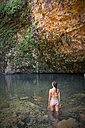 Western Australia, Young woman in swim suit at  Emma Gorge waterfall - MBE000663