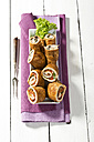 Tray of pork roulades with napkin on wooden table, close up - MAEF007224