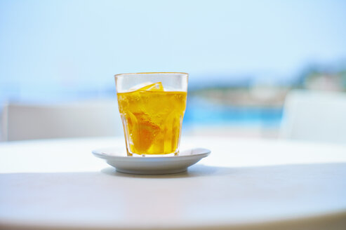 Italy, Glass of crodino drink at street cafe near beach - DIKF000066
