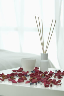 Aroma sticks with lavender flowers and rose petals on table, close up - ASF005107