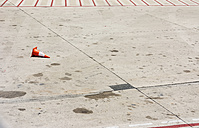 Spain, Barcelona, Empty airplane parking position with fallen traffic cone - ONF000222
