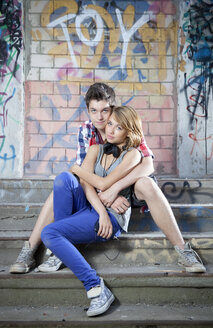 Germany, Berlin, Portrait of teenage couple sitting on stairs - MVC000003