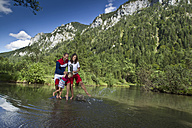 Germany, Bavaria, Chiemgau, Family crossing mountain lake - FF001373