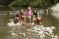 Germany, Bavaria, Chiemgau, Family at brook near Inzell - FF001364