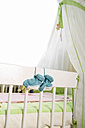 Blue baby shoes hanging to cot - KRP000030