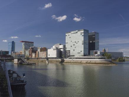 Germany, North Rhine Westphalia, Duesseldorf, View of Media harbour buildings - HHEF000054
