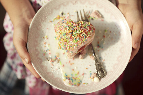 Germany. Bavaria, Girl holding plate with heart cake - STB000040