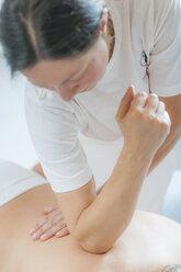 Traditional Chinese Medicine, TCM, female therapist during Tuina massage - MJF000379