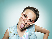Young woman sticking out her tongue - STKF000353
