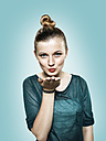 Teenage girl blowing a kiss - STKF000344