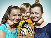 Little boy hugging two girls - STKF000341