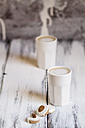 Cups of latte macchiatto with almond biscuits on wooden board - SBDF000178