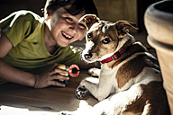 Germany, Boy playing with dog - SBD000205