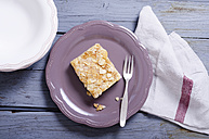 Yeast cake with almonds and sugar on plate - ODF000392