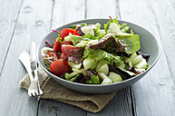 Mixed salad with tomatoes with vinegar and oil dressing - ODF000409