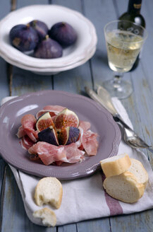 Sliced ham with figs, white bread and white wine - ODF000404