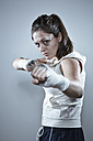 Portrait of a young female boxer in defending position - DSCF000114