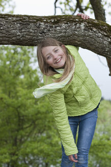 Germany, Bavaria, girl climbing on an oak - CRF002489