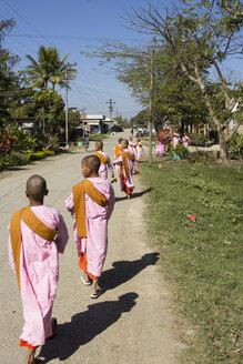Myanmar, Bagan, Group of nuns on rural road - DR000180