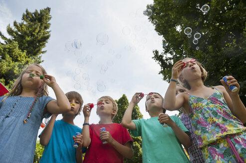 Children blowing soap bubbles - NHF001419
