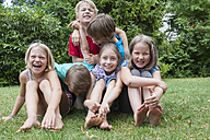Exuberant children in garden - NHF001437