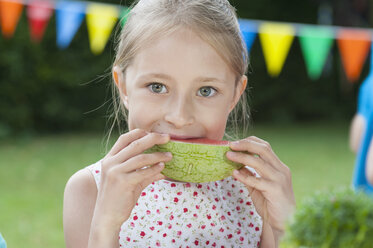 Happy girl eating watermelon on a birthday party - NHF001436