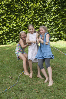 Girls playing tug-of-war on a birthday party - NHF001456