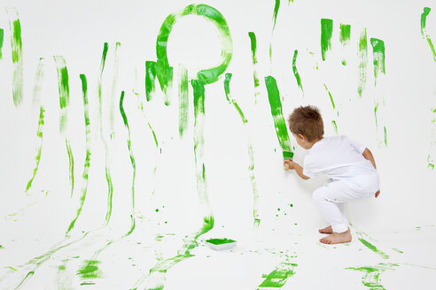 Toddler having fun with green paint - MVC000030