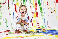 Toddler having fun with green paint - MVC000034