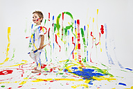 Toddler having fun with green paint - MVC000037