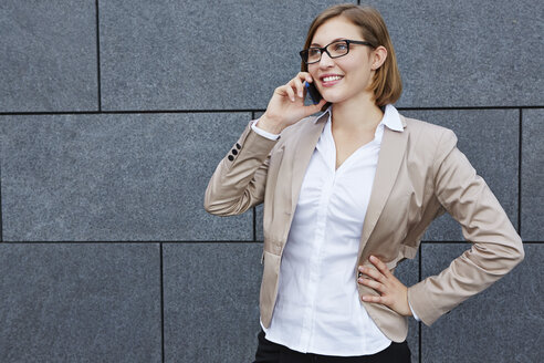 Germany, Businesswoman on the phone - RKNF000150