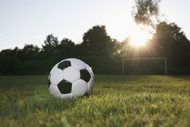 Germany, Cologne, Soccer ball on football field - PDF000426
