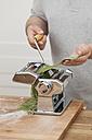 Man preparing green tagliatelle - ECF000348