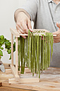 Man preparing green tagliatelle - ECF000351