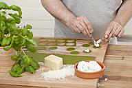 Man preparing green ravioli with ricotta - ECF000355
