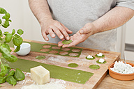 Man preparing green Tagliatelle - ECF000357