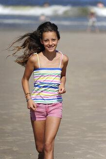Holland, Zeeland, Domburg, girl running on the beach - MIZ000398